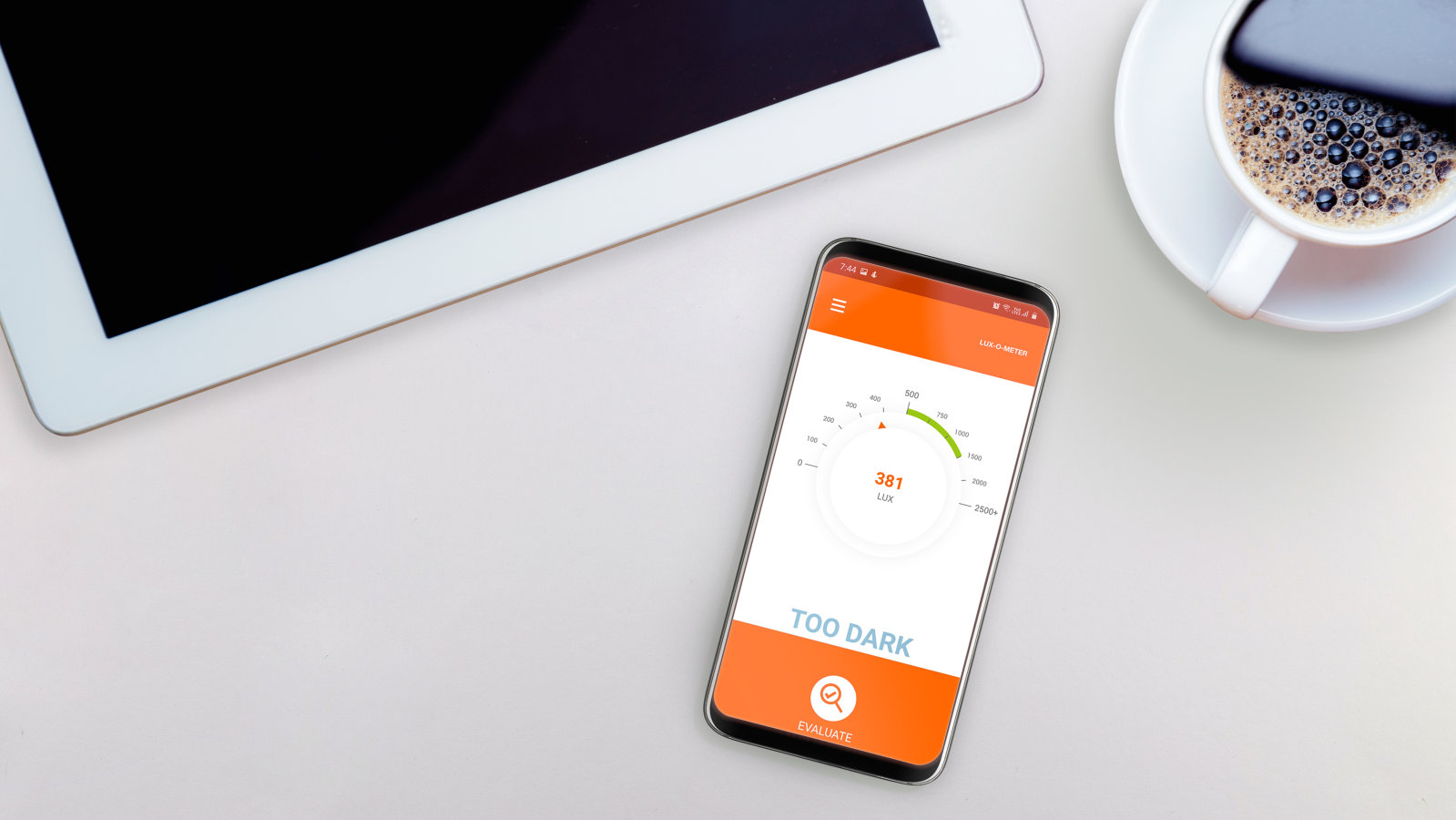 Smartphone with Lux-o-meter app on a desk